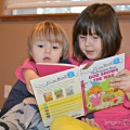 Reading to Her Brother (melts my heart)
